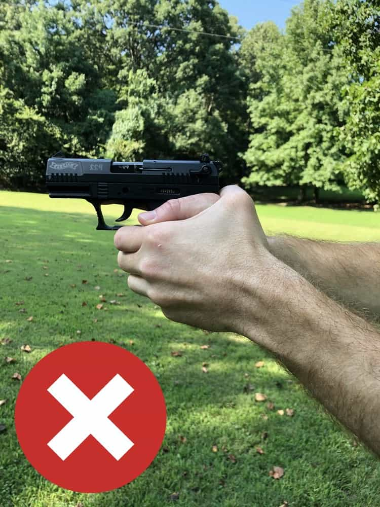 Don't cross your support hand thumb behind your handgun.