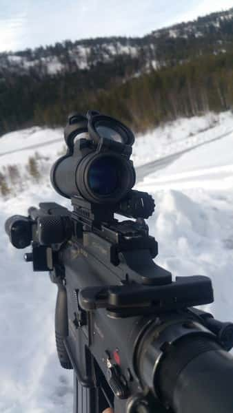 gun with sight with mountain background